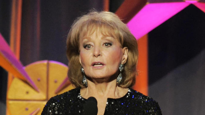 """FILE - This June 23, 2012 file photo shows Barbara Walters presenting an award onstage at the 39th Annual Daytime Emmy Awards in Beverly Hills, Calif. Walters has the chickenpox and remains hospitalized more than a week after going in after falling and hitting her head at a pre-inaugural party in Washington on Jan. 19. A fellow host on the """"The View,"""" Whoopi Goldberg, said Monday, Jan. 28, that Walters has been transferred to a New York hospital and hopes to go home soon. (Photo by Chris Pizzello/Invision/AP, file)"""