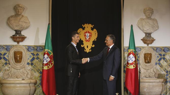 Portugal's soccer team captain Ronaldo shakes hands with Portugal's President Cavaco Silva after he was decorated with the Ordem do Infante Dom Henrique in Lisbon