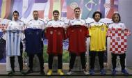(From L-R) Real Madrid's Angel Di Maria from Argentina, Karim Benzema from France, Iker Casillas of Spain, Cristiano Ronaldo from Portugal, Marcelo from Brazil and Luka Modric from Croatia pose with jerseys during a news conference to discuss the draw for the 2014 World Cup at the Valdebebas training grounds, outside Madrid, December 8, 2013. REUTERS/Javier Barbancho