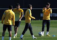 Barcelona players take part in a training session in Sant Joan d'Espi, near Barcelona on February 13, 2013. Barcelona full-back Adriano has said they won't be taking their trip to Granada this weekend lightly, despite holding a 12-point advantage at the top of the table