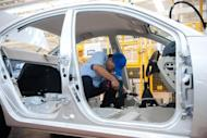 Workers assemble a car in the Chang'an automobile factory in Beijing in August 2012. President Barack Obama will launch a new WTO enforcement action against Chinese auto subsidies Monday, countering his Republican foe Mitt Romney's accusations that he is too timid towards Beijing.