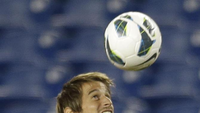 Fbio Coentro, a defender on Portugal's national soccer team, heads a ball during practice in Foxborough, Mass., Monday, Sept. 9, 2013. Portugal will play team Brazil in a friendly match Tuesday in Foxborough