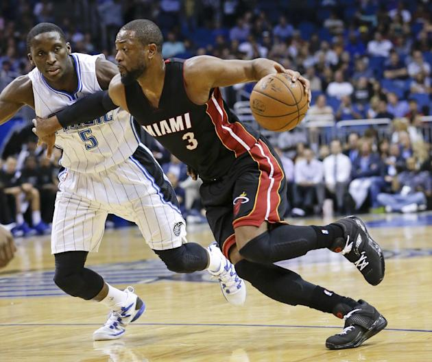 FILE - IN this Feb. 25, 2015, file photo, Miami Heat's Dwyane Wade (3) goes to the basket past Orlando Magic's Victor Oladipo (5) during an NBA basketball game in Orlando, Fla. A person famili