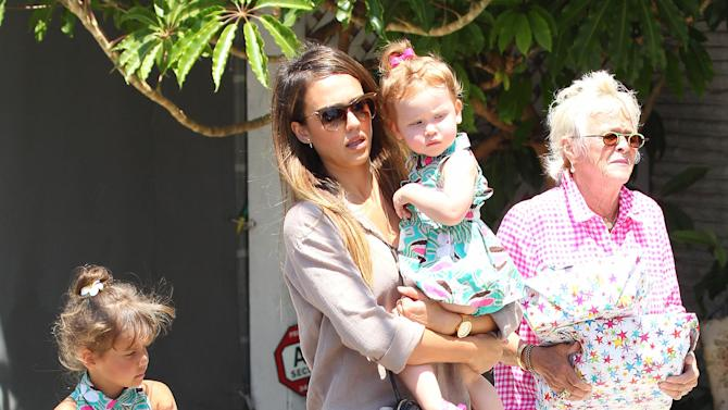 Jessica Alba with her daughters Haven Garner Warren and Honor Marie Warren, shopping for a present at Star Toys in Brentwood