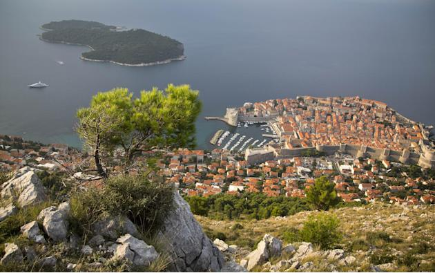 This Oct. 4, 2014 photo shows the Dubrovnik old town from a hill. Despite surging opposition to pumping crude in the waters of one of Europe's fastest-growing summer travel destinations, the Croat