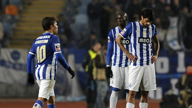 FC Porto's Juan Quintero from Colombia, left, Eliaquim Mangala from France and Lucho Gonzalez, from Argentina, react after Academica's goal in a Portuguese League soccer match at the Municipal Stadium in Coimbra, Portugal, Saturday, Nov. 30, 2013. Academica won 1-0 causing Porto's first defeat in the championship