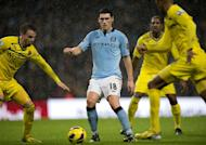 Manchester City's midfielder Gareth Barry fights for the ball during their Premiership football match against Reading at The Etihad stadium in Manchester, northwest of England on December 22, 2012. Barry scored an injury-time winner and Manchester City won the game 1-0