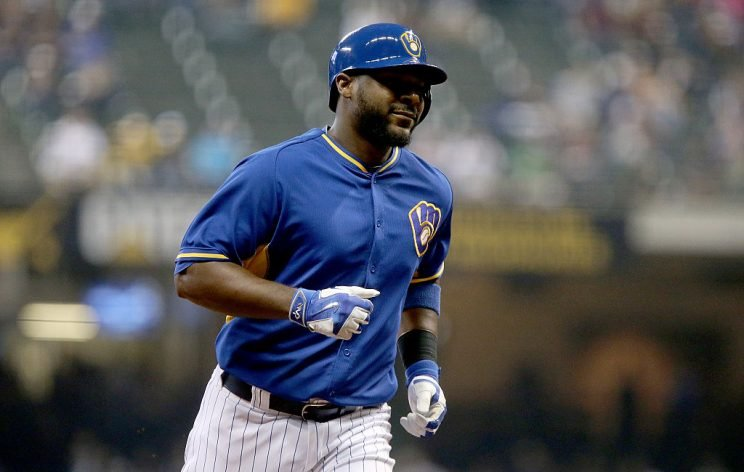 MILWAUKEE, WI - SEPTEMBER 23: Chris Carter #33 of the Milwaukee Brewers rounds the bases after hitting a home run in the second inning against the Cincinnati Reds at Miller Park on September 23, 2016 in Milwaukee, Wisconsin. (Photo by Dylan Buell/Getty Images)