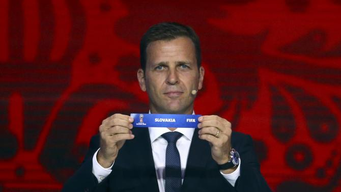 "Former German soccer player Bierhoff holds up the slip showing ""Slovakia"" during the preliminary draw for the 2018 FIFA World Cup at Konstantin Palace in St. Petersburg"
