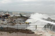 Waves crash onto the shore at a fishing harbour in Visakhapatnam district in the southern Indian state of Andhra Pradesh October 12, 2013. REUTERS/R Narendra