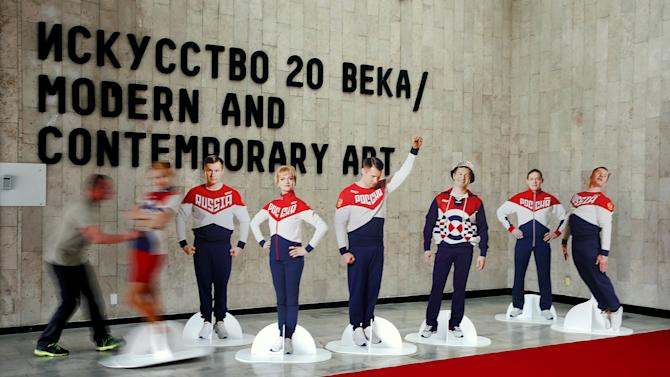 Figures with images of Russian athletes are on display after ceremony to present Rio 2016 Olympic Games kit of team Russia in Moscow