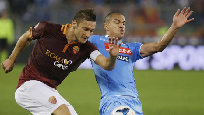 AS Roma's Francesco Totti, left, and Napoli's Gokhan Inler of Switzerland vie for the ball during a Serie A soccer match between AS Roma and Napoli at Rome's Olympic stadium, Friday, Oct. 18, 2013