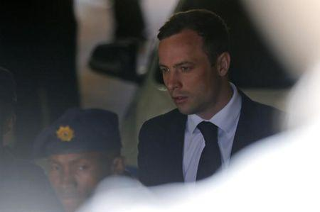 South African Olympic and Paralympic sprinter Pistorius is led to a prison van after his sentencing in Pretoria