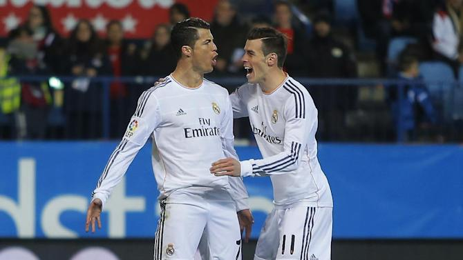 Real's Cristiano Ronaldo, left, celebrates his goal with teammate Gareth Bale during a semifinal, 2nd leg, Copa del Rey soccer match between Atletico de Madrid and Real Madrid at the Vicente Calderon stadium in Madrid, Spain, Tuesday Feb. 11, 2014