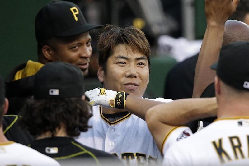 Pittsburgh Pirates' Jung Ho Kang, center, celebrates with teammates in the dugout after hitting a solo home run off Los Angeles Dodgers starting pitcher Nick Tepesch during the third inning of a baseball game in Pittsburgh, Friday, June 24, 2016. (AP Photo/Gene J. Puskar)