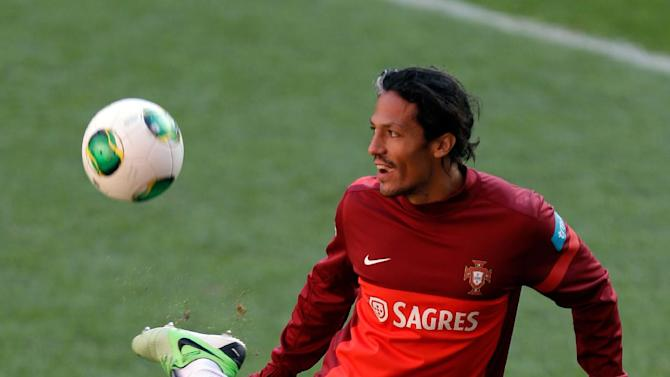 Portugal's Bruno Alves plays with a ball during a training session Sunday, Nov. 17 2013, at the Luz stadium in Lisbon. Portugal will play Sweden Tuesday in a World Cup qualifying playoff second-leg soccer match