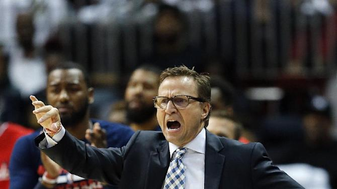 Washington Wizards head coach Scott Brooks tries to get his players' attention in the first half on an NBA basketball game against the Atlanta Hawks, Thursday, Oct. 27, 2016, in Atlanta. (AP Photo/John Bazemore)