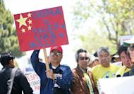 Anti-China protesters gather outside of the Consulate General of China in San Francisco, on May 11, to protest against an escalating territorial dispute over the Scarborough Shoal, a tiny rocky outcrop in the South China Sea, about 230 km from the Philippines' main island of Luzon