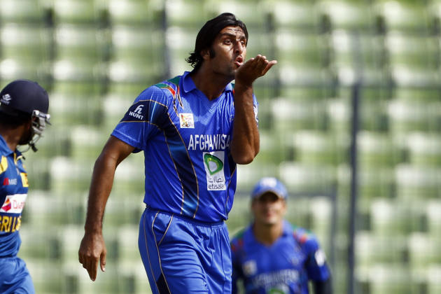 Afghanistan's Shapoor Zadran celebrates after taking the wicket of Sri Lanka's Lahiru Thirimanne during the Asia Cup one-day international cricket tournament between them in Dhaka, Bangladesh, Monday,