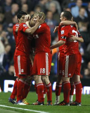 Liverpool's Glen Johnson, left, is hugged by Dirk Kuyt, centre, after scoring during the English Premier League soccer match between Chelsea and Liverpool at Stamford Bridge Stadium in London, Sunday, Nov. 20, 2011. (AP Photo/Kirsty Wigglesworth)