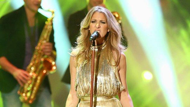 "Later that same evening, Celine hit the stage for an inspired performance of the Ike & Tina Turner classic, ""River Deep - Mountain High,"" in a gold fringed Versace halterneck dress and strappy, nude-hued stilettos that highlighted her gorgeous gams. (11/22/2012)"
