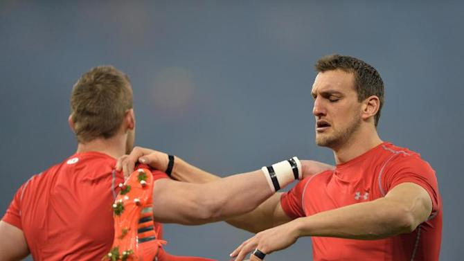 Wales's flanker Sam Warburton (R) warms up before the Six Nations international rugby union match between Wales and England at the Millennium Stadium in Cardiff on February 6, 2015