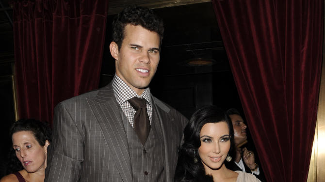 FILE - This Aug. 31, 2011 file photo shows Kim Kardashian and Kris Humphries attending a party thrown in their honor at Capitale in New York. The couple's divorce is unlikely to be concluded before the end of the year, with Humphries' attorneys seeking detailed records from companies that handle the reality starlet's shows and the depositions of her mother-manager Kris Jenner and current boyfriend Kanye West. Kardashian, 31, and Humphries, 26, were wed Aug. 20 in a star-studded, black-tie ceremony at an exclusive estate in California. (AP Photo/Evan Agostini, file)