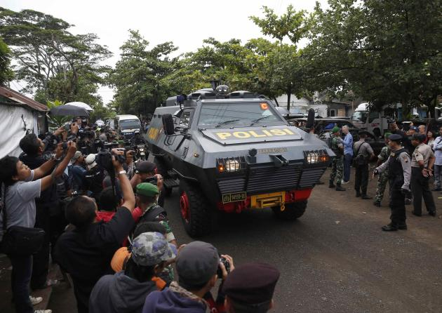 An armoured police vehicle believed to be carrying two Australian prisoners, arrives at the port to take a ferry to the prison island of Nusa Kambangan, where upcoming executions are expected to take