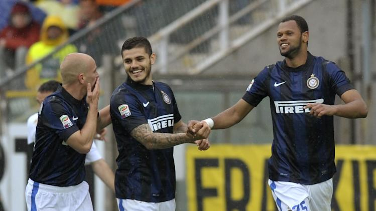 Inter Milan's Jorge Fonseca Rolando of Portugal, right, celebrates with his teammates Mauro Icardi, center, and Estebasn Cambiasso, after scoring against Parma during their Italian Serie A soccer match at Tardini stadium in Parma, Italy, Saturday, April 19, 2014