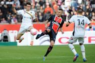 Paris Saint-Germain's French midfielder Jeremy Menez (C) vies with Sochaux' French forward Rafael Dias (L) and Sochaux' French midfielder Marvin Martin during the French L1 football match PSG vs. Sochaux at the Parc des Princes in Paris. Paris Saint-Germain defeated Sochaux 6-1