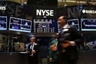 Traders work on the floor of the New York Stock Exchange on January 28, 2013, in New York City. US stocks finished lower Thursday, with BlackBerry maker Research in Motion losing 5.8 percent after launching a new operating system and Dow Chemical sagging nearly 7 percent on a quarterly loss.