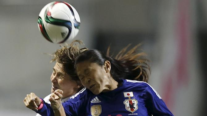 Japan's Sawa fights for the ball against Italy's Girelli during their women's international friendly soccer match in Nagano