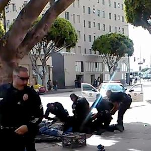 LAPD says homeless man shot by cop was reaching for officer's gun
