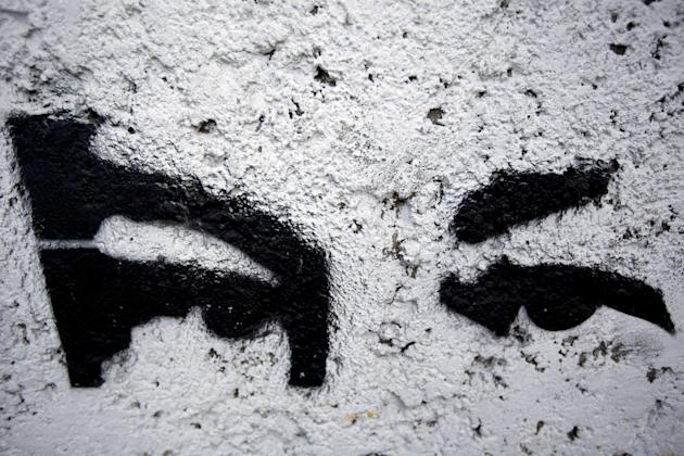 A mural representing the eyes of Venezuela's late President Hugo Chavez decorate a wall in Caracas, Venezuela, Wednesday, March 4, 2015. Chavez used his country's oil wealth to launch social p