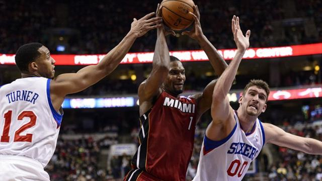 Basketball - Bosh and LeBron star in Heat victory over 76ers