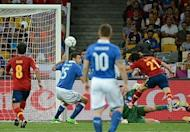Spain midfielder David Silva (right) gets ahead of Italy defender Andrea Barzagli (C) to score with a header during the Euro 2012 final at the Olympic Stadium in Kiev on July 1. Spain beat Italy 4-0 to successfully defend their title