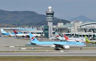 Aircraft are seen sitting on the tarmac at Incheon international airport, west of Seoul, on May 2. South Korea said on Wednesday it would send formal complaints to North Korea and to UN agencies, urging Pyongyang to stop sending GPS jamming signals that have affected hundreds of civilian flights