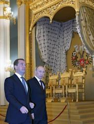Russia's outgoing President Dmitry Medvedev (left) with his mentor and successor, Prime Minister Vladimir Putin in the Moscow Kremlin, on April 24. Putin and Medvedev are to host Li Keqiang, the man predicted to become the next premier of China, for politcal and economic talks
