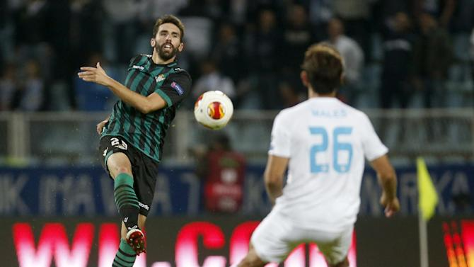 Betis' Jordi, left, is challenged by Rijeka's Mate Males during their group I Europa League first round second leg soccer match, at Kantrida stadium in Rijeka, Croatia, Thursday, Oct. 3, 2013