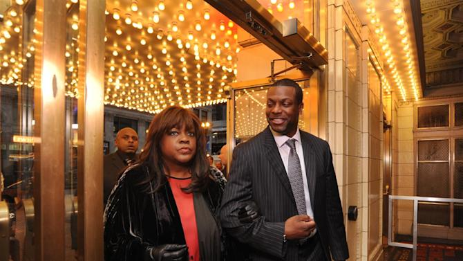 Roger Ebert's wife Chaz Ebert, left, and actor Chris Tucker, right, walk inside The Chicago Theater before a memorial for film critic Roger Ebert in Chicago, Thursday, April 11, 2013. The Pulitzer Prize winning critic died last week at the age of 70 after a long battle with cancer. (AP Photo/Paul Beaty)