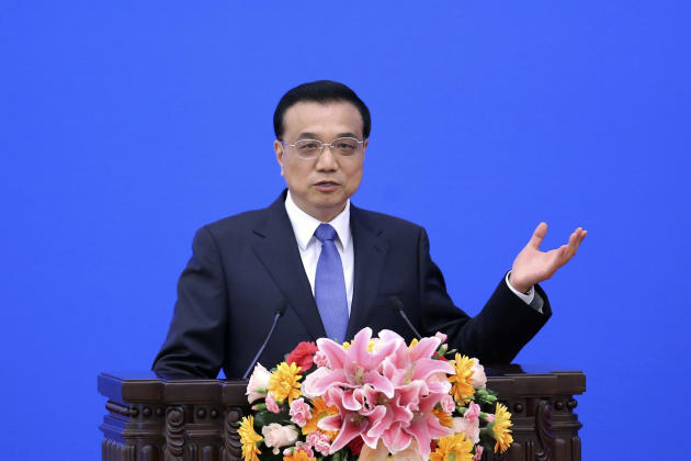 China's Premier Li Keqiang speaks during the Indonesia-China Economic Cooperation Forum at the Great Hall of the People  in Beijing Friday, March 27, 2015. (AP Photo/Feng Li, Pool)