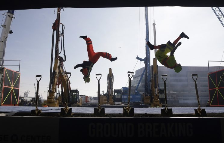 Acrobats and construction equipment perform at the Chase Center groundbreaking ceremony. (AP)