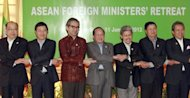 "This file photo shows ASEAN foreign ministers posing for a picture during their previous official gathering in Siem Reap, Cambodia, in January. Southeast Asian and European foreign ministers began meeting in Brunei on Friday to chart a ""new chapter"" in their relations now that democratic reforms are under way in former pariah Myanmar"