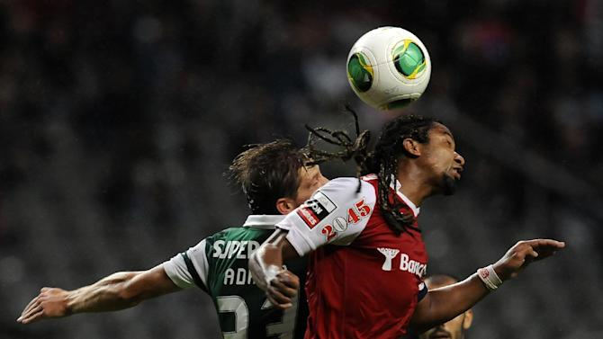 Sporting's Adrien Silva, left, challenges for a high ball Sporting Braga's Alan Silva, from Brazil, during their Portuguese League soccer match at the Municipal Stadium, in Braga, Portugal, Saturday Sept. 26, 2013