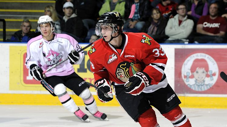 Nic Petan #33 of the Portland Winterhawks skates on the ice at the Kelowna Rockets