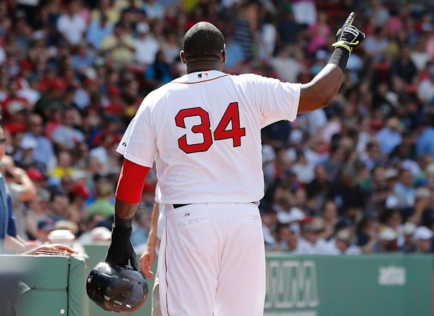 David Ortiz motions to the official scorer at Fenway Park, letting him know he didn't agree with the error ruling. (Getty Images)