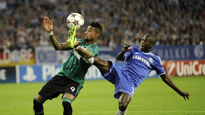 Schalke's Kevin-Prince Boateng, left, and Chelsea's Ramires challenge for the ball during the Champions League group E soccer match between FC Schalke 04 and Chelsea FC in Gelsenkirchen, Germany, Tuesday, Oct. 22,2013