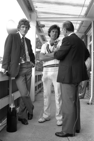 Sep 1982 : Imran Khan of Pakistan talks to Peter West after the 3rd Test between England and Pakistan at Headingley, Leeds.  England Captain Bob Willis looks unimpressed with proceedings on the left.