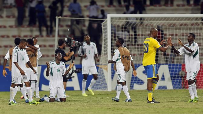 Taiwo Awoniyi of Nigeria reacts after winning their U-17 UAE World Cup semi-final soccer match against Sweden in Dubai