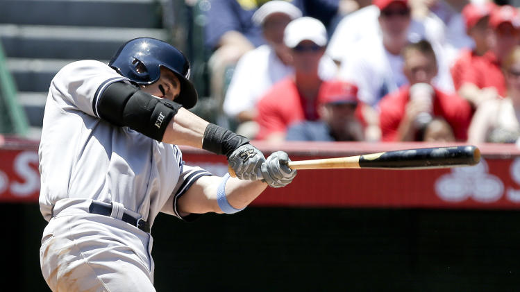 New York Yankees' Travis Hafner hits a tree-run home run against the Los Angeles Angels during the third inning of a baseball game in Anaheim, Calif., Sunday, June 16, 2013. (AP Photo/Chris Carlson)